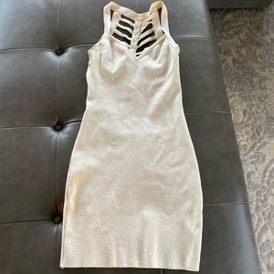 Cream mini dress with open back detail